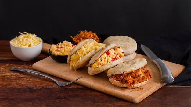 Assortment of arepas on chopping board