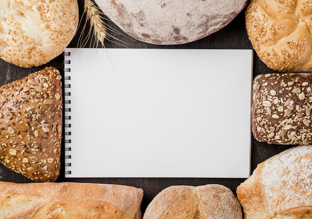 Assortment of baked bread with notepad