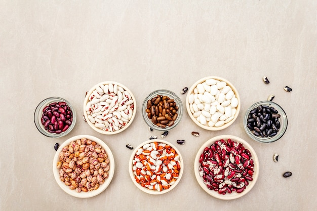 Assortment of beans on bowls
