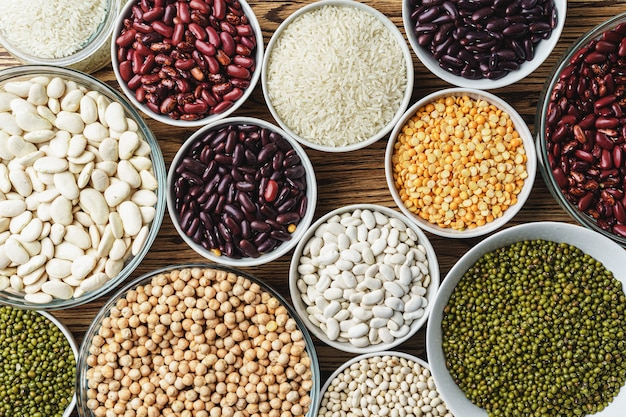 Assortment of beans on wooden background. close up.