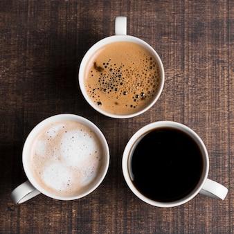 Assortment of black coffee and milk coffee flat lay