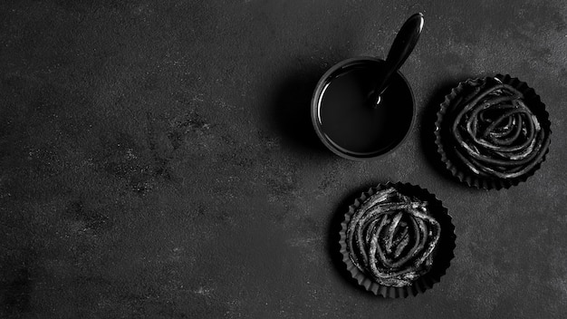 Assortment of black delicious food on dark table with copy space