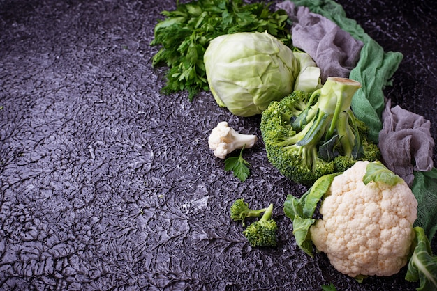 Assortment of cabbages on concrete background