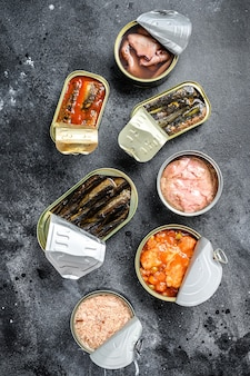 Assortment of cans, canned with different types of fish and seafood