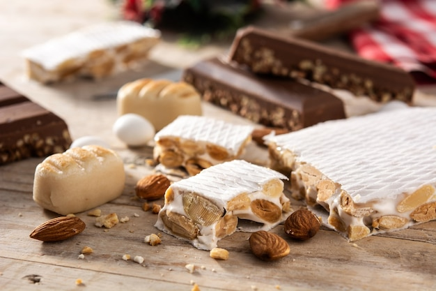 Assortment of christmas nougat on wooden