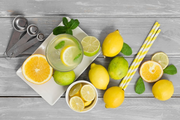 Assortment of citrus with straws