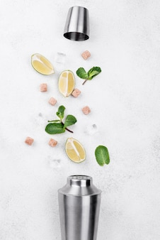 Assortment of cocktail ingredients on white background