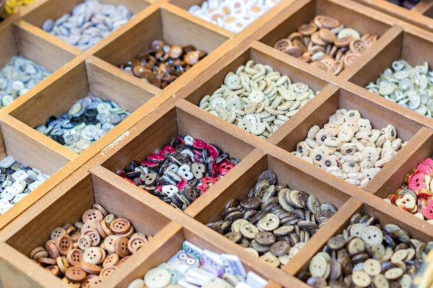 Assortment of colorful ceramic buttons and beads for making handmade accesories.