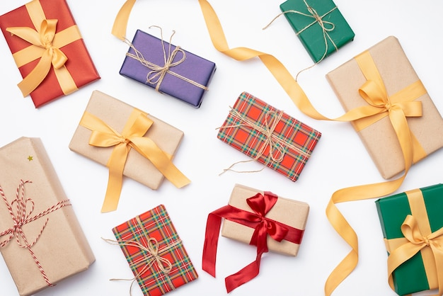 Assortment of colorful christmas presents with ribbon