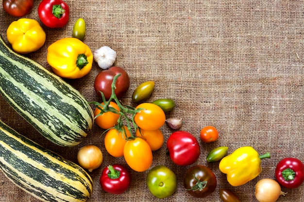 Assortment of colorful fresh vegetables on sackcloth surface