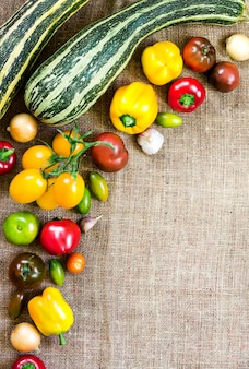 Assortment of colorful fresh vegetables on sackcloth. top view