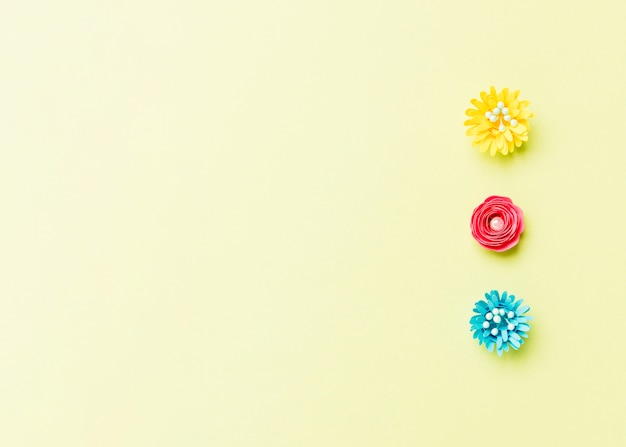 Assortment of colorful paper spring flowers with copy space