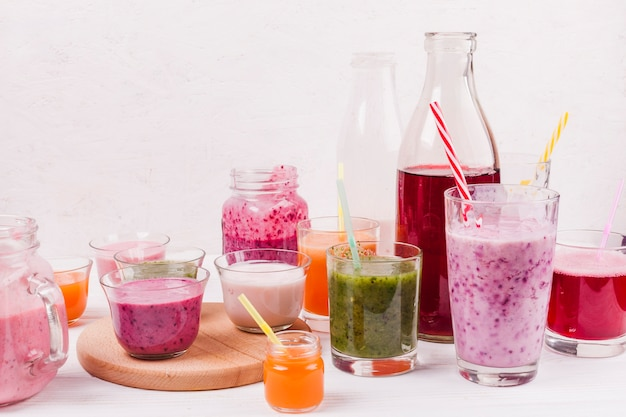 Assortment of colorful smoothies on table