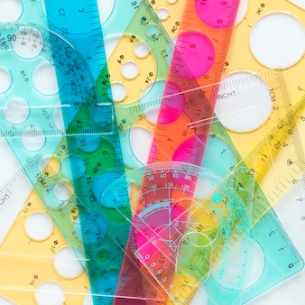 Assortment of colourful rulers top view