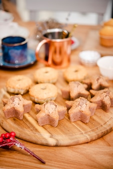 Assortment of cookies on wooden board