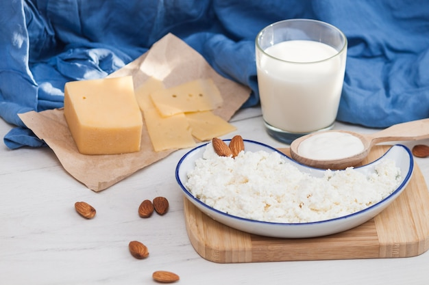 Assortment of dairy milk prodacts cheese, milk, creame, cottage cheese. nature organic products concept.