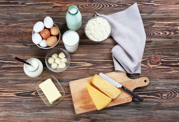 Assortment of dairy products on wooden background