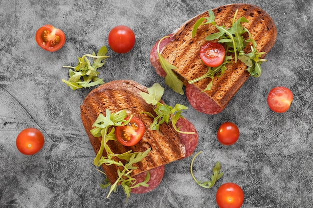 Assortment of delicious sandwiches and tomatoes