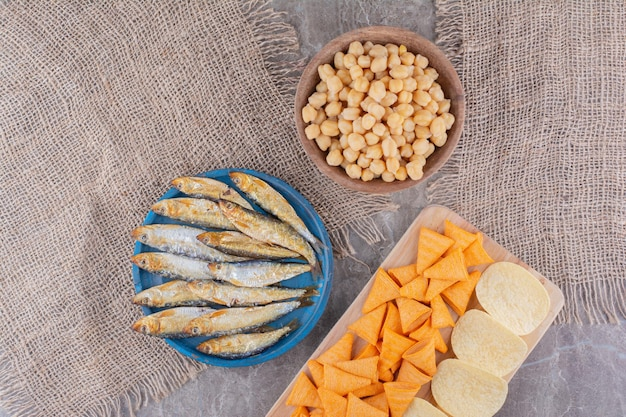 Assortment of delicious snacks on marble surface. high quality photo