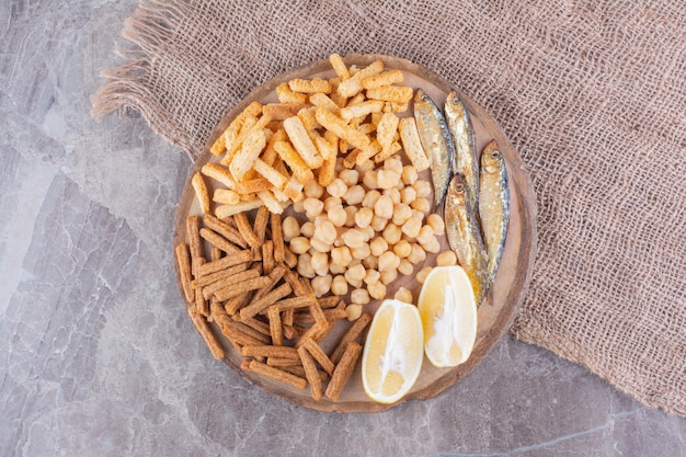 Assortment of delicious snacks on wooden piece. high quality photo