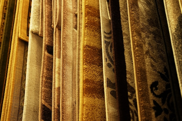 Assortment of different carpets in store. close up