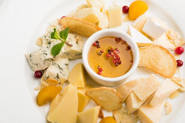 Assortment of different cheeses with honey for a snack