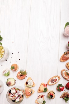 Assortment of different snacks, top view copyspace background