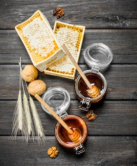 Assortment of different types of honey. on a wooden.