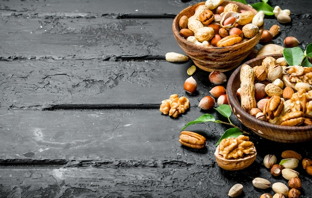 Assortment of different types of nuts in bowls.