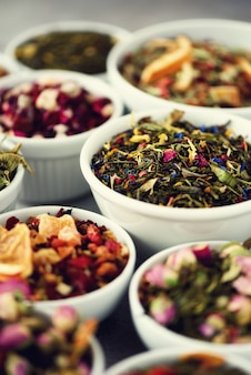 Assortment of dry tea in bowls.