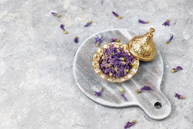 Assortment of dry tea in golden vintage mini plates. tea types