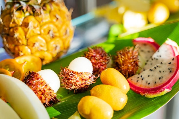 Assortment of exotic tropical fresh food background. healthy eating, vegan and summer exotic fruits. close-up