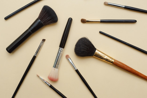 Assortment of feminine make-up facial brushes. flat lay beauty background.