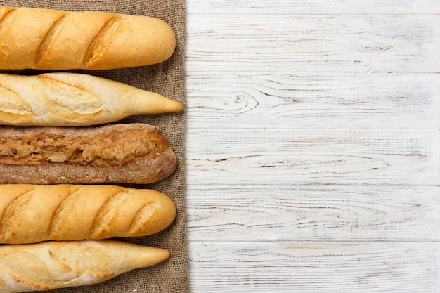 Assortment of fresh french baguettes on a wooden table