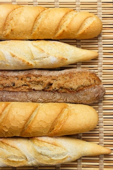 Assortment of fresh french baguettes on a wooden table.