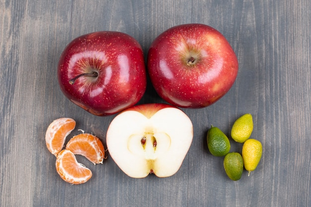 Assortment of fresh fruits on wooden surface