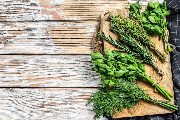 Assortment of fresh herbs coriander, rosemary, thyme, dill, parsley