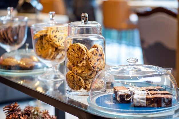 Assortment of fresh home made cookies and cakes in glass jar bakery shop