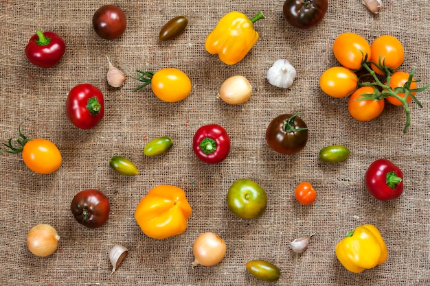 Assortment of fresh vegetables on sackcloth surface