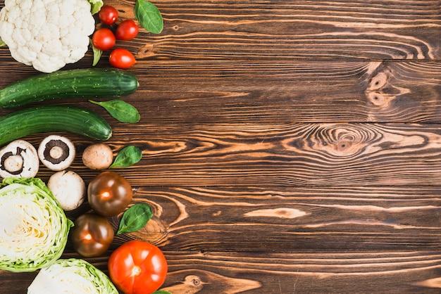 Assortment of fresh vegetables on wooden table