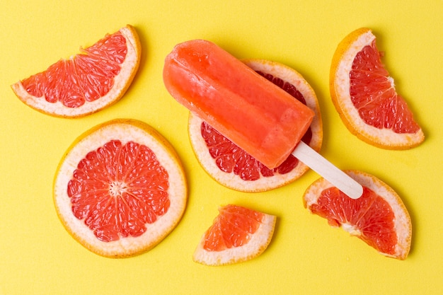 Assortment of fruit popsicles and slices of grapefruit