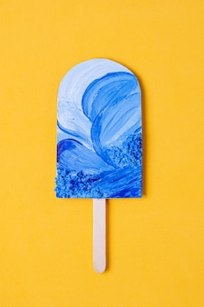 Assortment of fruit popsicles with ocean blue waves