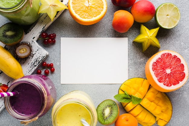 Assortment of fruit and smoothies with copy space