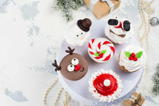 Assortment of funny christmas cupcakes