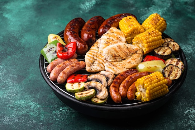 Assortment of grilled sausages, meat, and vegetables. picnic barbeque concept