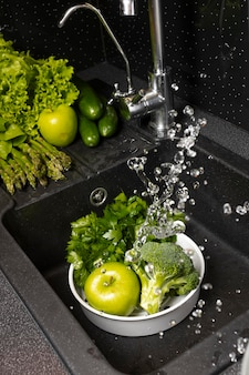 Assortment of healthy food being washed