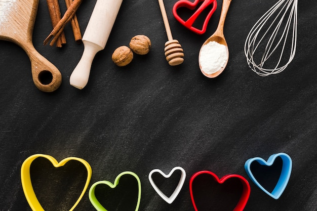Assortment of kitchen utensils with colorful heart shapes