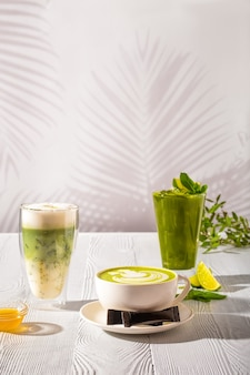 Assortment of matcha green tea beverages - ice green tea, frappe and hot milk green tea