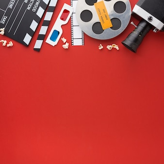 Assortment of movie elements on red background with copy space