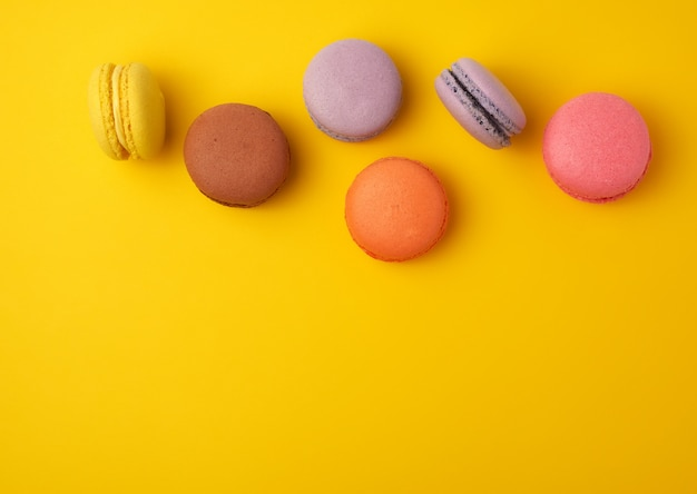 Assortment of multi-colored baked round macarons